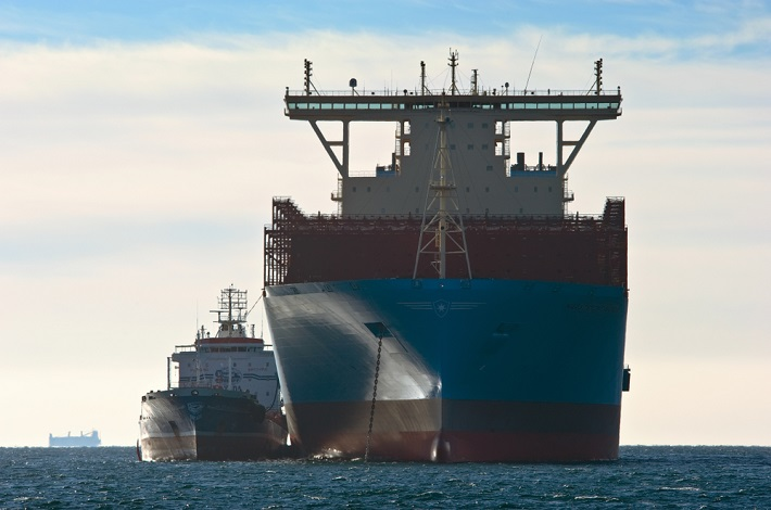 A container ship accepts fuel.
