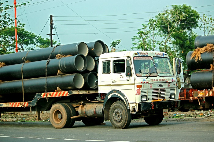 A truck travels on a road in India.