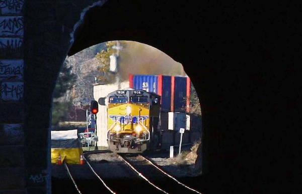 Union Pacific double-stack train in tunnel