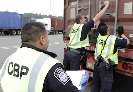 Customs inspectors check cargo container at port