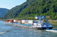 A barge travels on the Rhine River.
