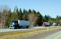 Trucks travel on a road in California, United States.