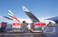 Air cargo being loaded on an Emirates plane.