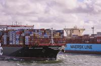 Maersk and MSC vessels pass each other outside the Port of Rotterdam.