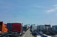 "Long lines such as this one to enter the Port of New York and New Jersey are common around the U.S. and have more drayage drivers turning to ""street turns,"" which help truckers avoid time-consuming trips into terminals to return or pick up boxes."