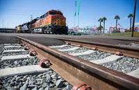 A train travels near the the Port of Long Beach.