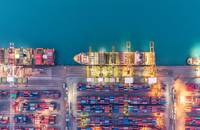 A container ship and containers at a port.