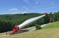 A truck transport a wind generator blade.