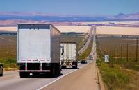 Trucks travel on a US road.