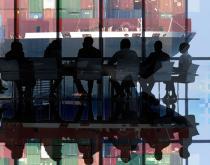 boardroom looking at massive container ship through windows, Sue design
