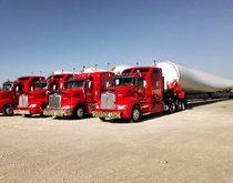 Lone Star Transportation trucks hauling wind turbine parts.