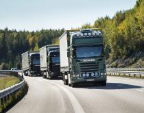 A convoy of Scania trucks rolls through Europe.