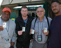 Dockworkers pose with their Transportation Worker Identification Credentials, which were mandated by Congress in the aftermath of the Sept. 11 terror attacks.