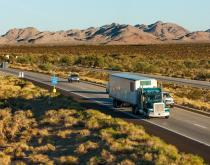 A truck travels on a US highway.