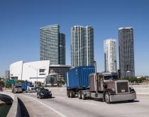 A truck travels in Miami.