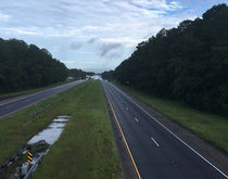 A section of I-12 lies flooded and abandoned in Louisiana as severe flooding impacted the movement of goods on the Gulf Coast for the third time this year.