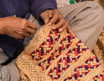 Indian exports, such as this handcrafted jute weaving, are rebounding after a slide that lasted more than year.