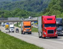 Trucks travel on a US highway.