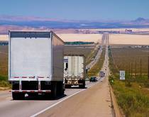 Trucks travel on a US road.