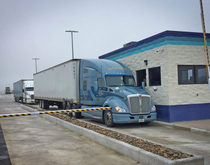 A truck makes its way out of Werner's Laredo, Texas, terminal, where work on an expansion to meet the company's changing needs recently wrapped up.