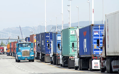trucks line up at gates at Oakland port