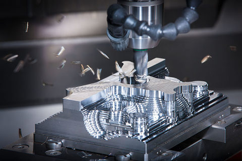 Computer numeric control machining, pictured, is used to make complex shapes and components for industrial manufacturing. Toolots is a specialized web platform for shippers of such machinery.