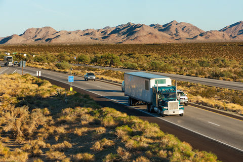 Truck and traffic moving across America on interstate I-10, Arizona