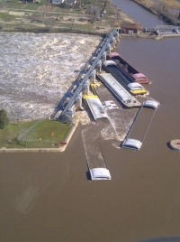 Seven barges rest against the Marseilles Dam, Marseilles, Ill., after the motor vessel Dale A. Heller lost control of its tow on April 18, due to strong river currents from heavy rainfall.