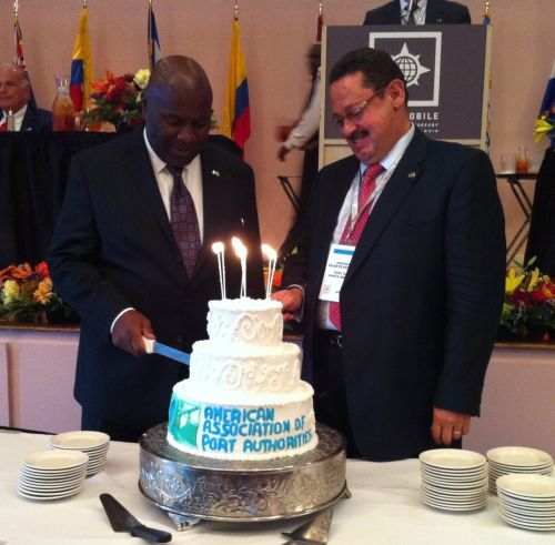 AAPA 100th birthday cake cutting with AAPA Chair Armando Duarte (right) and Immediate Past Chair Jerry Bridges.